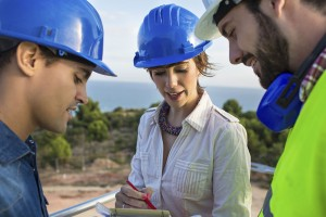 architect-and-builders-talking-on-site